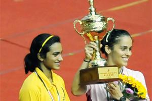 Saina Nehwal poses with the winner's trophy after defeating PV Sindhu in the Syed Modi International India Grand Prix Gold final.