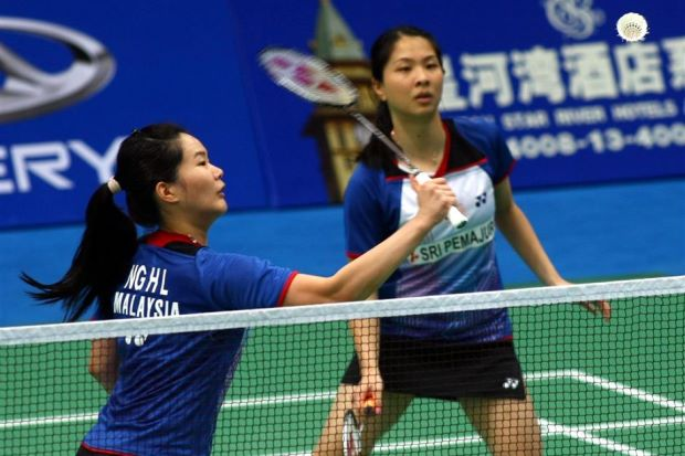 Ng Hui Lin (left) and Ng Hui Ern in action during the World Championships in China last year.