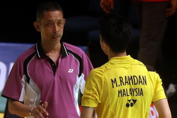 Misbun Sidek (left) seen here coaching his son, Misbun Ramdan at the 2014 Malaysian Open last month.