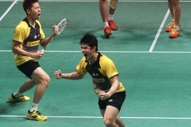 Lim Khim Wah (right) and Goh V Shem celebrate after winning the Malaysian Open men's doubles last month. They will be taking part in the upcoming German Open GP Gold and All-England tournaments.