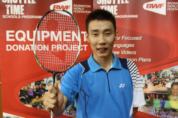 Lee Chong Wei with the racquet he donated to Badminton World Federation's Equipment Donation Project.