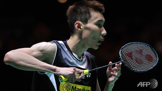 Lee Chong Wei of Malaysia prepares to return against Son Wan Ho of South Korea during their All England Open Badminton Championships men's singles semi-final match in Birmingham, central England.