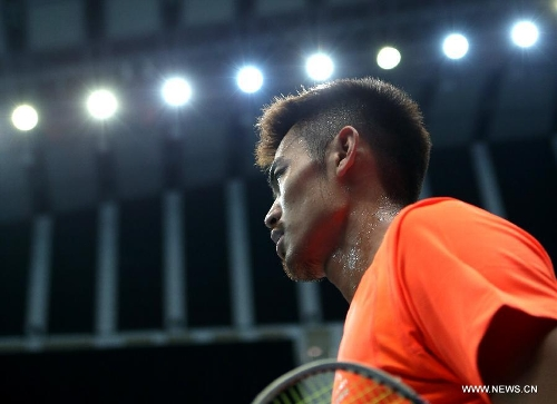 China's Lin Dan reacts during the men's singles third round match against Kazumasa Sakai of Japan at the Badminton Asia Championships in Taipei, southeast China's Taiwan, on April 18, 2013. Lin won 2-1.