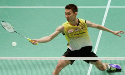 Back to you: Lee Chong Wei returns a shot to Taiwan's Yang Chih-hsun during their Group C opening match at the Putra Stadium yesterday.