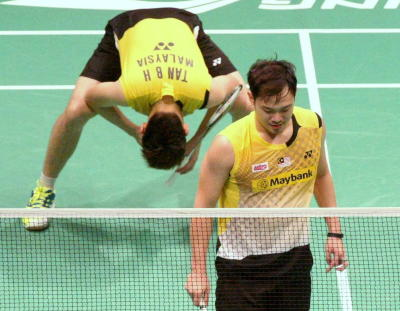 Shameful: Malaysia's Koo Kien Keat and Tan Boon Heong react after losing to Taiwan's Lee Sheng mu-Tsai Chia-hsin on Sunday.