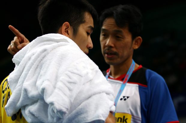 Malaysia's Chong Wei Feng receiving some words of advice from national singles chief coach Rashid Sidek (right) during his first round match against England's Rajiv Ouseph.