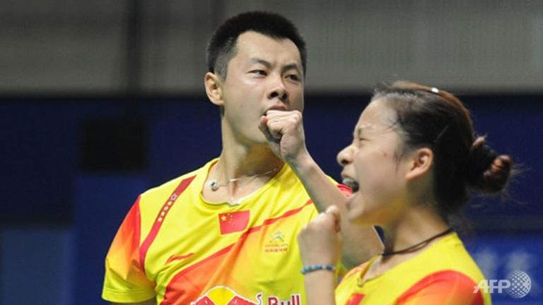 China's world number one badminton mixed doubles pair Xu Chen (L) and Ma Jin.