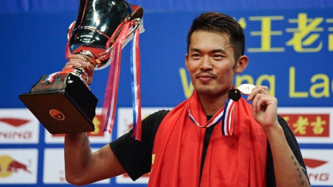 Lin Dan holds the winner's trophy after defeating Lee Chong Wei at the World Badminton Championships in China on August 11, 2013. He breezed into the final without dropping a game, even against China's world number two Chen Long in the quarter-finals.