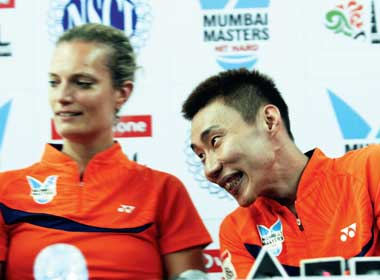 Lee Chong Wei (right) with his Mumbai Masters' teammate and All England winner Tine Buan at the National Sports Club of India yesterday. Mumbai Masters take on Delhi Smashers in their IBL encounter today