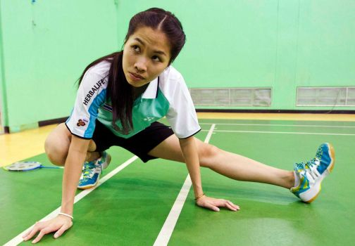 In this Friday, Aug. 16,2013 photo, Thailand's Ratchanok Inthanon warms up during a training session in Bangkok, Thailand. The Thai teenager last week became the youngest-ever world badminton champion, and the first Thai player to win a world title.