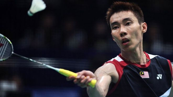 Lee Chong Wei returns to Lin Dan during their men's singles final at World Badminton Championships in Guangzhou, south China's Guangdong province, on August 11, 2013. Lee was later stretchered from the court during the match, with cramp and dehydration, in the latest heartbreaking defeat to his nemesis.