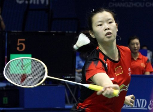 World number-one Li Xuerui, shown September 14, 2013, has pulled out of the badminton Japan Open because of a sore knee, with her teammate linking the problem to a jam-packed schedule for Chinese players.