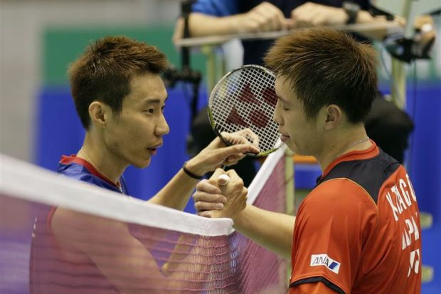 Kenichi Tago (right) congratulating Lee Chong Wei after clinching the Japan Open title in Tokyo on Sunday. Chong Wei beat Tago 23-21, 21-17.