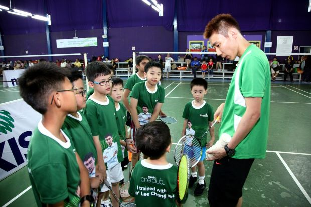 Lee Chong Wei seen here giving young kids a coaching clinic in this filepic. The world No.1 shuttler would love to have a longer break after returning from his European swing but he has been entered for the back-to-back China and Hong Kong Opens beginning 12 November.