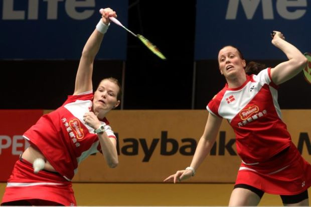 Danish pair Christinna Pedersen (left) and Kamilla Rytter Juhl return a shot to Korean pair Chae Yoo Jung-Kim Ji Won during their first-round match in the Maybank Malaysian Open on Jan 15, 2014. The Danish pair won 16-21, 21-11, 21-17.